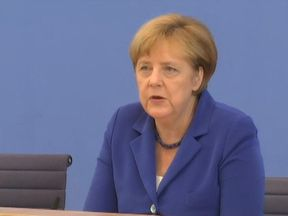 "Mrs Merkel promised to do all she could to clear up the ""barbaric acts"""