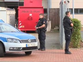 Police outside the Weserpark shopping centre in Bremen. Pic: Bild