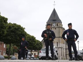 French police stand guard outside the church in Saint-Etienne-du-Rouvray