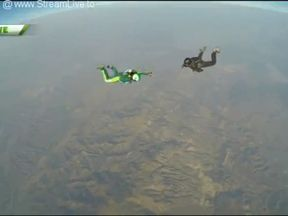 Stuntman Luke Aikens falls 25,000ft without a parachute and lands on a net