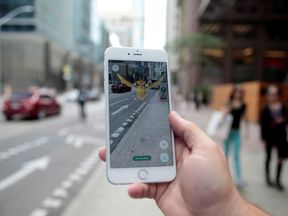 Playing Pokemon GO in downtown Toronto