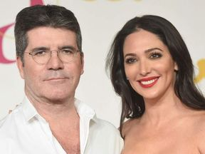 Simon Cowell and his girlfriend Lauren Silverman
