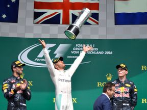 Lewis Hamilton celebrates his victory in the German Grand Prix