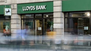 People was past a branch of Lloyds bank in central Londo