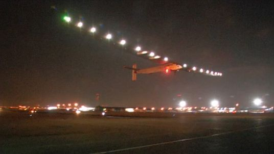 The plane takes off in the Cairo darkness