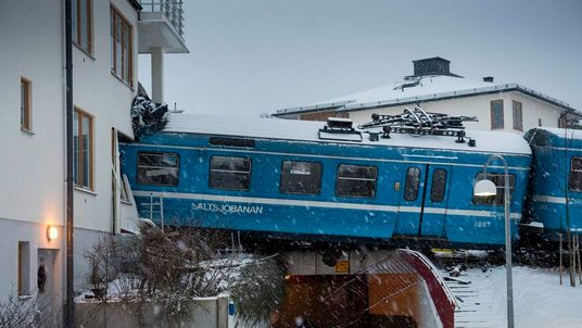 Local train that derailed and crashed into a residential building in Saltsjobaden is seen outside Stockholm