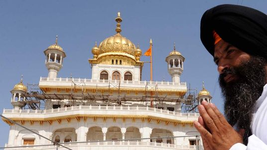 An Indian Sikh devotee offers prayers at Amritsar's Golden Temple on the anniversar of 1984's Operation Blue Star.