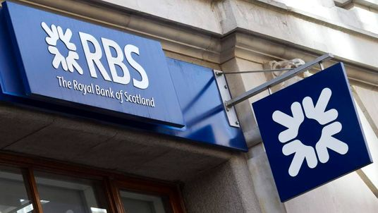 A Royal Bank of Scotland (RBS) sign is p