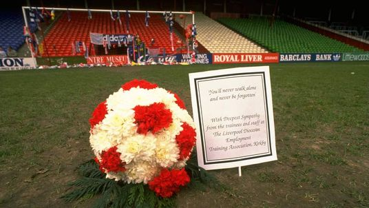 A floral football tribute lies on the pitch at Anfield in 1989 after the Hillsborough disaster