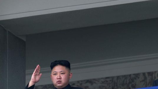 North Korean leader Kim Jong-un salutes.