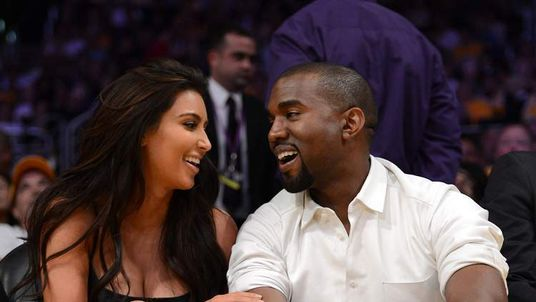 Kim Kardashian and Kanye West at a basketball match