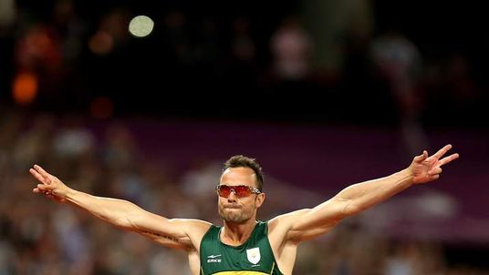 Oscar Pistorius of South Africa celebrates
