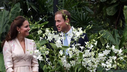 Catherine, Duchess of Cambridge and Prince William, Duke of Cambridge smile as they look at an orchid named in honour of Diana, Princess of Wales at Singapore Botanical Gardens on day 1 of their Diamond Jubilee tour