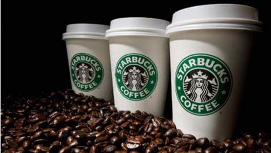 Starbucks cups and coffee beans