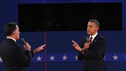 Republican presidential candidate Mitt Romney (L) and U.S. President Barack Obama talk to each other during a town hall style debate