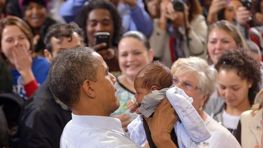 President Obama picks a baby from the crowd at a rally in Ohio