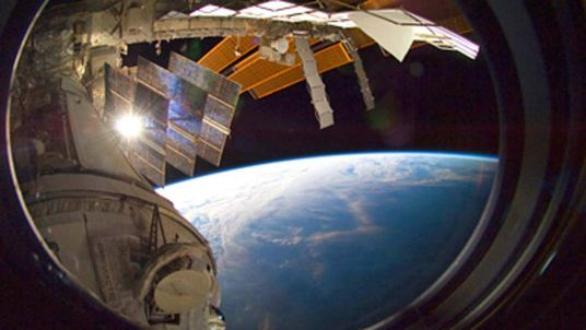 Backdropped by Earth's horizon and the blackness of space, a portion of the International Space Station is featured in this image photographed by a crew member aboard the station.