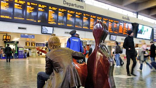 Passenger waits at Euston station