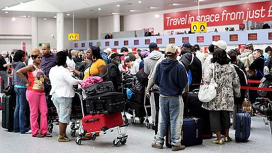 Passengers queue at Gatwick Airport during the ash cloud chaos