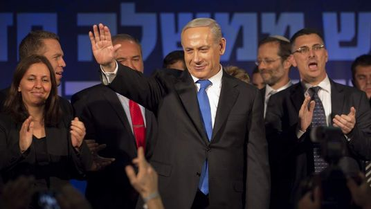 Israeli Prime Minister Benjamin Netanyahu waves to supporters after his election win