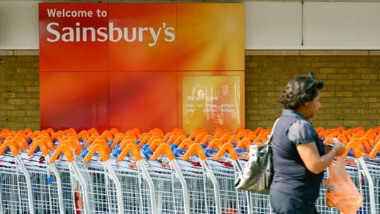 A customer walks in front of a Sainsbury's store in south London.