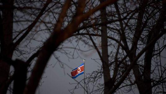 A North Korean flag flies above the North Korean embassy in Beijing