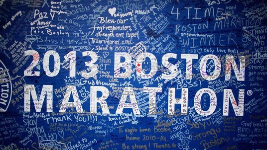 Signatures adorn a Boston Marathon poster near the site of the Boston Marathon bombings