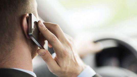 Man Driving Using Mobile Phone