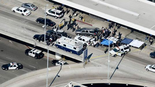 Law enforcement official gather at a command centre on the upper level of LAX