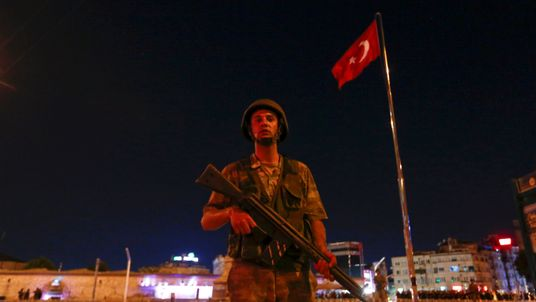 A Turkish soldier stands guard near Taksim Square in Istanbul