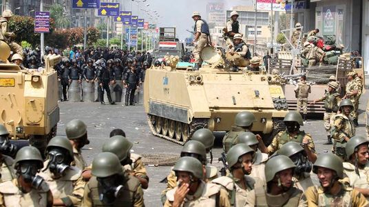Riot police and army personnel take them up positions during clashes with members of the Muslim Brotherhood and supporters of ousted Egyptian President Mohamed Mursi in Cairo