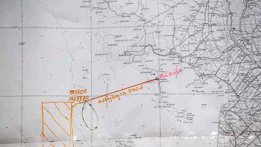 Flight route on a map is seen during a news conference about search and rescue operation to find missing Malaysia Airlines flight MH370 at Phu Quoc Airport