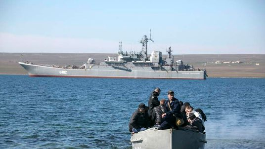 "Crew members of the blockaded Ukrainian naval landing vessel ""Konstantin Olshansky"" come ashore after leaving the ship in Donuzlav bay in Crimea"
