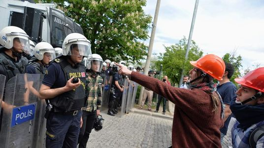 Demonstrators argue with riot police as they demonstrate to blame the ruling AK Party (AKP) government on the mining disaster in western Turkey, in Ankara