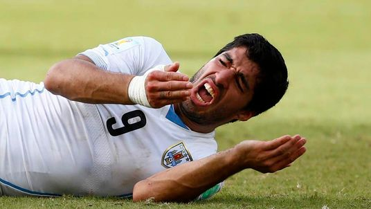 Uruguay's Luis Suarez reacts after clashing with Italy's Giorgio Chiellini during their 2014 World Cup Group D match at the Dunas arena in Natal.