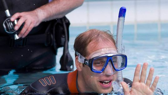 Britain's Prince William snorkels at a swimming pool, with British Sub-Aqua Club members, in central London