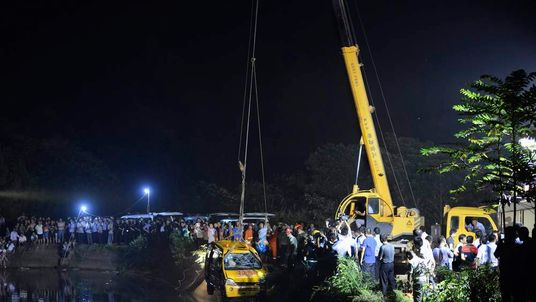 A school bus is lifted from a reservoir after an accident in Xiangtan
