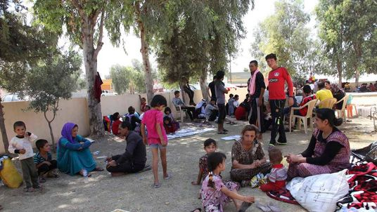 Displaced people from the minority Yazidi sect, fleeing the violence in the Iraqi town of Sinjar west of Mosul, take refuge at Dohuk province