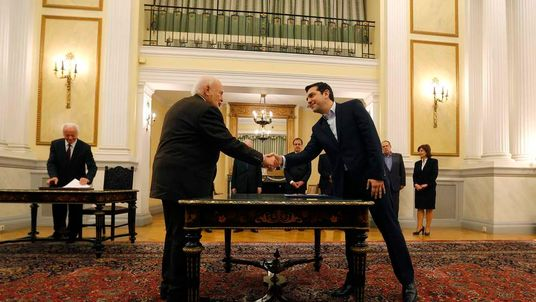 Tsipras shakes hands with Greek President Papoulias during his swearing-in ceremony as Greece's first leftist Prime Minister, at the Presidential palace in Athens
