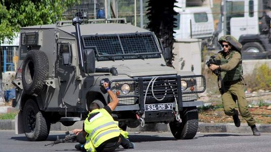Palestinian posing as a journalist stabs an Israeli soldier with a knife before being shot dead near the West Bank city of Hebron