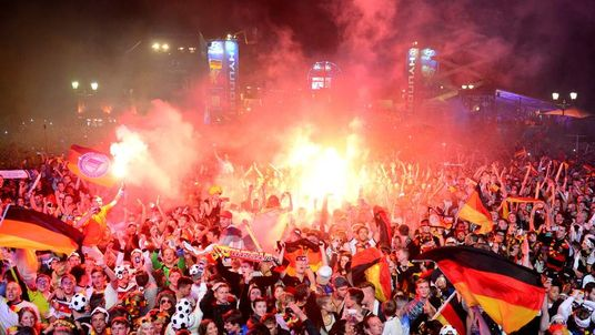 German fans celebrate at an outdoor screening near the Brandenburg Gate in Berlin.