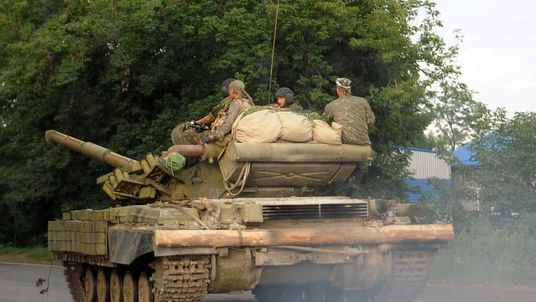 Pro-Russian separatists ride a tank near Donetsk.