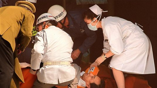A commuter is treated outside a station in Tokyo after a sarin gas attack in 1995