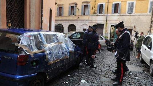 Police at the scene of an explosion outside a French church in Rome.