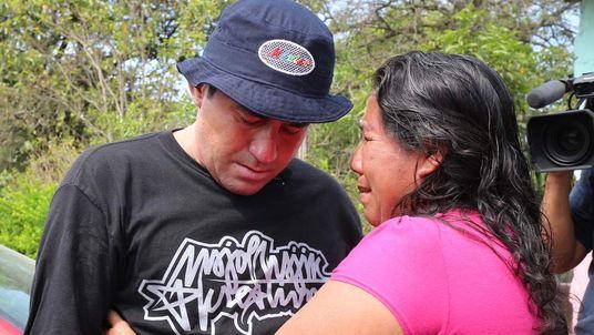 Salvadorean castaway Jose Salvador Alvarenga (L) greets Roselia Diaz (R), mother of dead castaway Ezequiel Cordoba