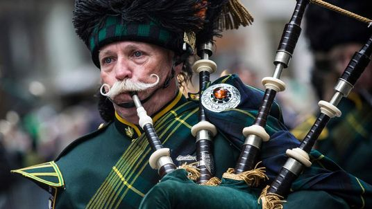 A bagpiper marches up New York's Fifth Avenue in the St Patrick's Day Parade.