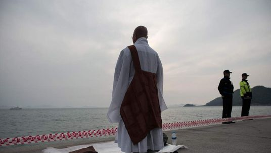 A monk leads a prayer session in an area where family members of passengers on board capsized South Korean ferry Sewol.
