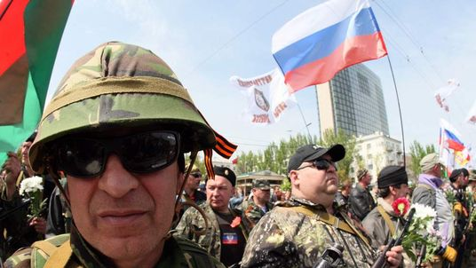 Armed pro-Russia militiants take part in a rally marking Victory Day in eastern Ukrainian city of Donetsk