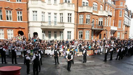 A general view of the police presence and people gathered as they wait for WikiLeaks founder Julian Assange.
