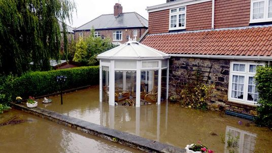A flooded back garden in Morpeth as the water levels rose and persistent heavy downpours continued, causing some areas to experience a whole month's rainfall in just 24 hours.